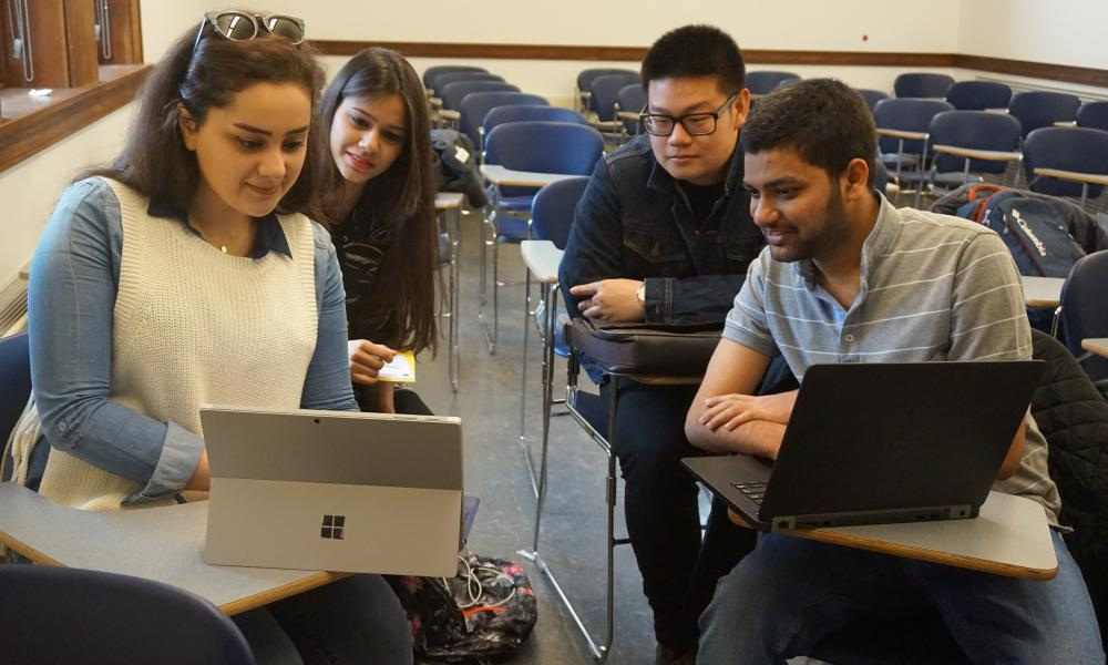 Students Studying on Laptops